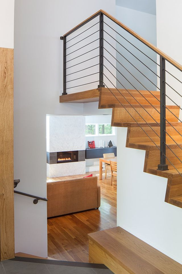 Modern residential architecture. The various levels flow together in a an open way. The lower level floor slab was insulated assuring a warm and comfortable living space.