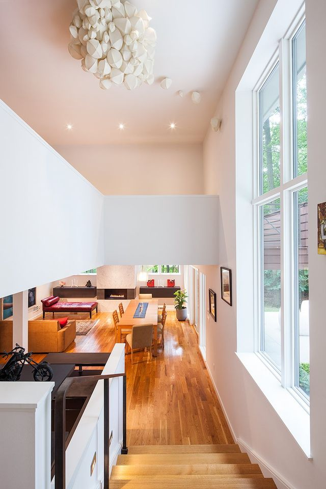 Modern residential architecture. From the kitchen, the view down to the lower level and up to a mezzanine on the master bedroom level.