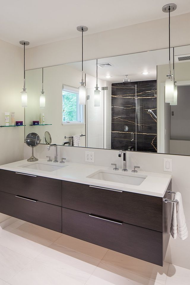 Modern residential architecture. The Master Bathroom Vanity Avalon Two by Vanity Fair from Hardware Designs. Plumbing fixtures by General Plumbing Supply. Light Candle Pendants by Sonneman from Arch St Lighting. Marble Slab in Shower is African St. Laurent