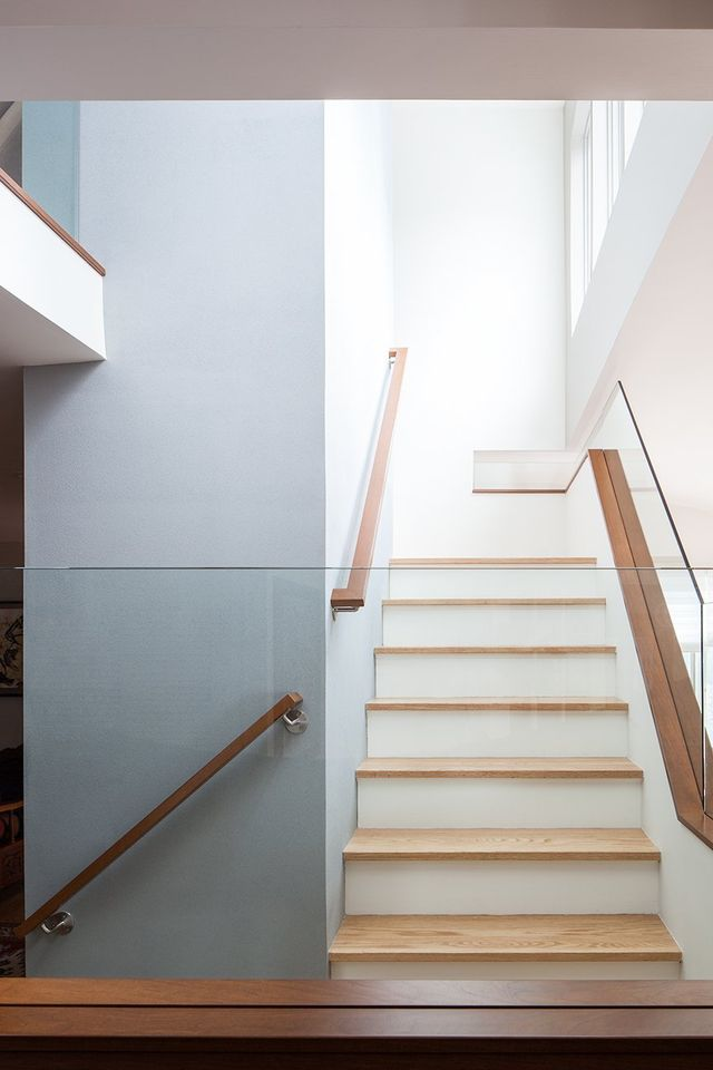 Modern residential architecture. This simple stair has openings in all directions and filters light from above into adjoining spaces.