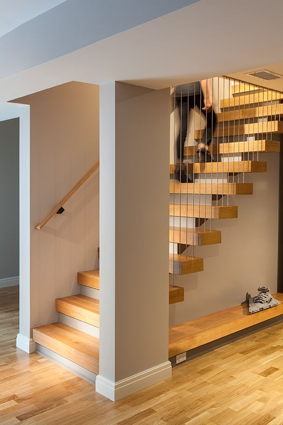 Modern residential architecture. This stair provides a focal point in the renovated basement.