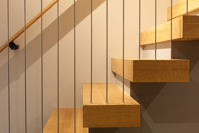 Modern residential architecture. Cable rail system provides a minimal guard at open end of stair.