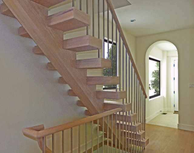 Modern residential architecture. This open riser stair was able to meet current building code requirements for openings through the use of 4