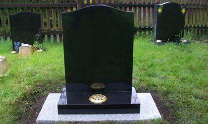 black marble grave stone