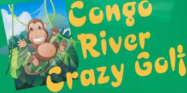 Cartoon chimp on green and yellow sign for Congo River Crazy Golf Course