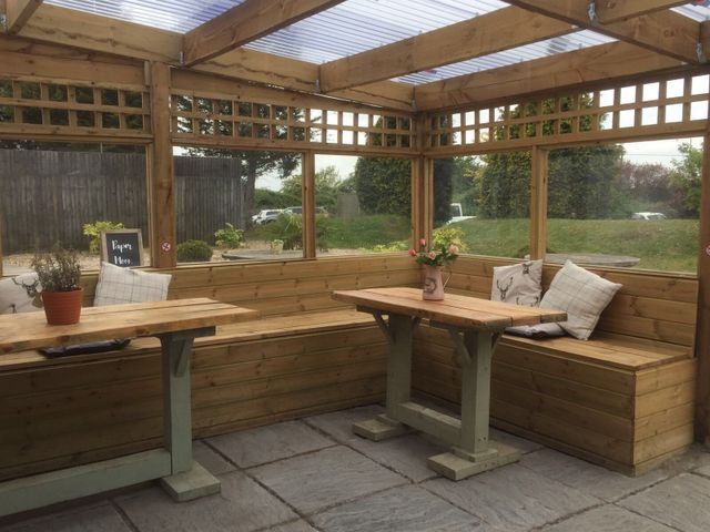 rose garden cafe outside wooden seating area