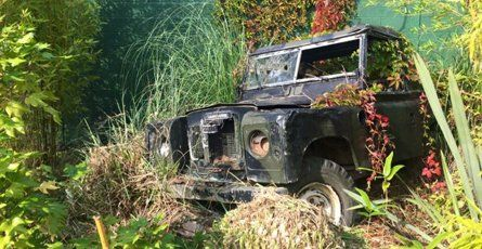 A battered Land Rover in a forest area on our Florida style adventure crazy golf course