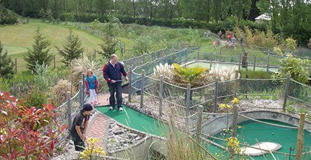 Father and daughter on the crazy golf course