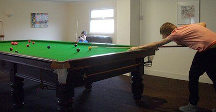 Playing pool in the club house