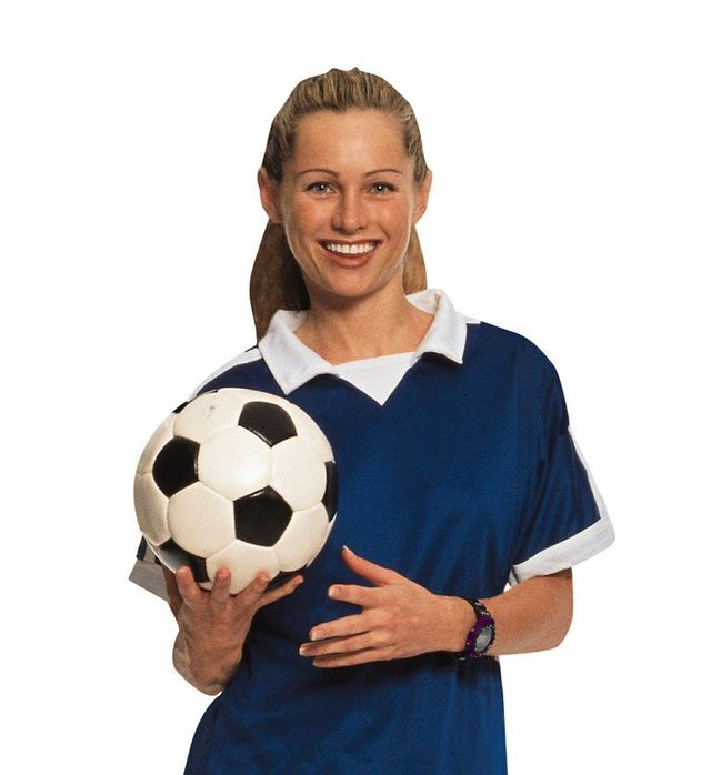 woman with soccer ball smiling