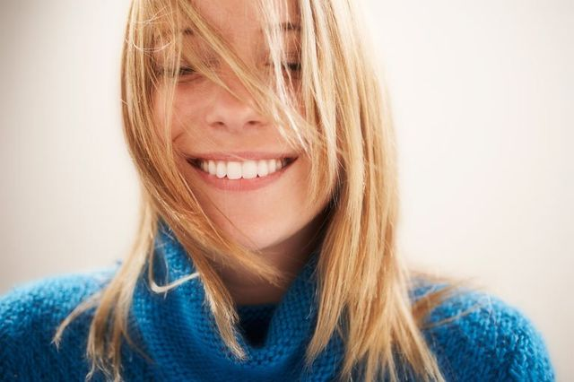 girl in winter jumper smiling