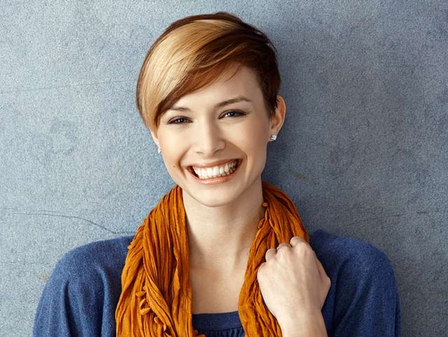 young lady in scarf smiling