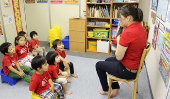 ESL teacher reading to children in Japan.