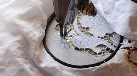 Embroidery being added to a white garment