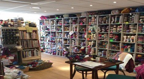 Shelves of yarn, accessories and fabric in our shop