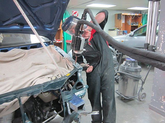 A repair man in car workshop
