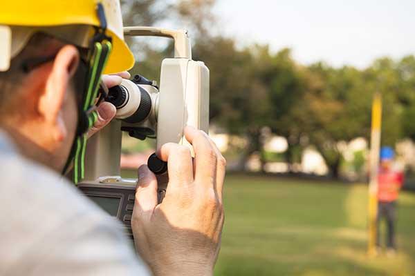 Surveyor engineer with partner making measure