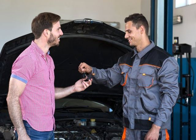 mechanic handing over keys