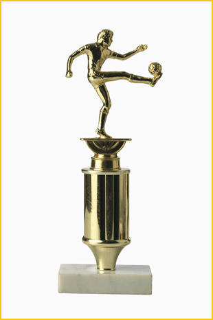 Gold coloured football award of player kicking ball