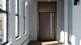 una porta con una maniglia grande in acciaio e un numero 7