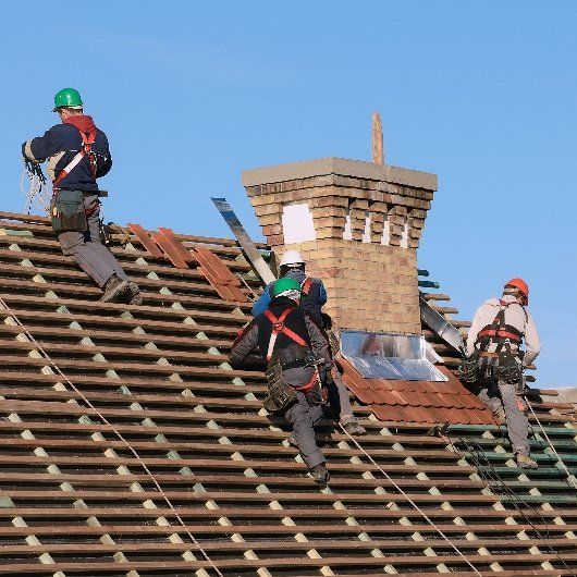 Several men working on roof top