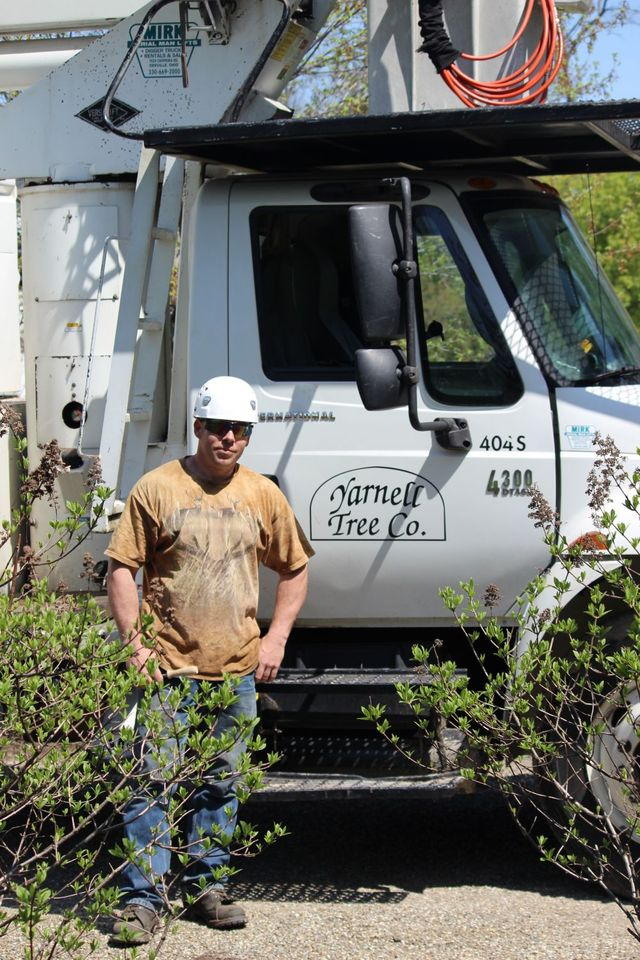 Yarnell Tree Co. truck and one of our employees