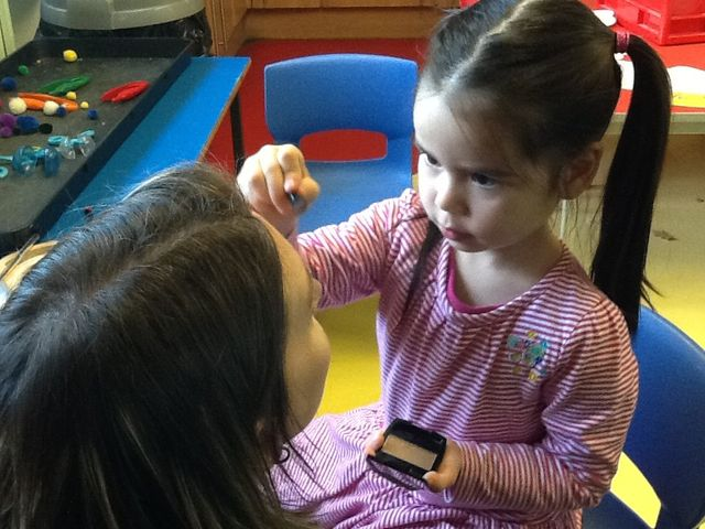 Baby applying a makeup
