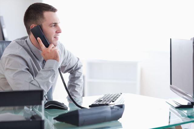 man contacting communication company in Hilo, HI