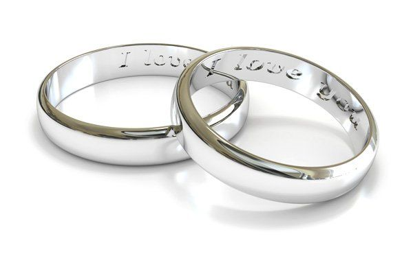 two engraved platinum wedding bands
