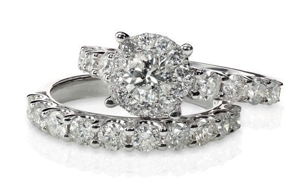 two white gold and diamond engagement rings stacked