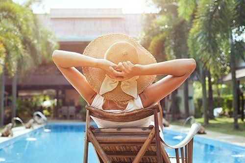 Young women relaxing near the pool