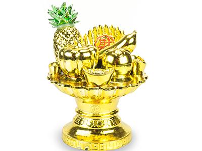 oggetto in oro che raffigura una coppa di frutta