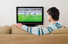 Digital TV - Aldershot, Hampshire - Attfield Aerials - Man watching TV on sofa