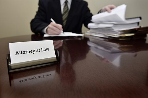Attorney taking down notes for his legal battle in Austin, TX