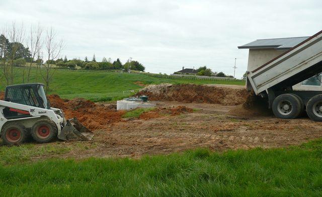 excavating machine from Hamilton readies a job