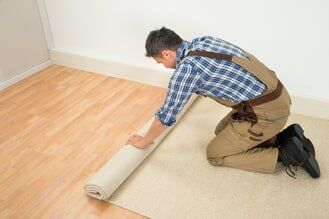 Unrolling Carpet On Floor Flooring Services In Greenville Nc