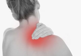 Patient experiencing neck and shoulder pain from whiplash from a car accident in Pensacola, FL