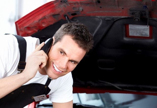 Automotive repairs professional on the phone in Palmerston North
