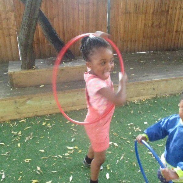 girl playing with the hula-loop