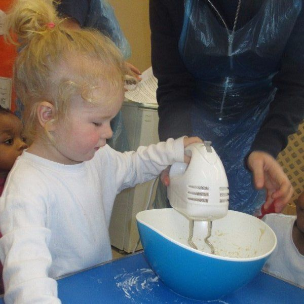 child helping in baking