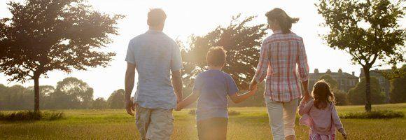Family walking in a field