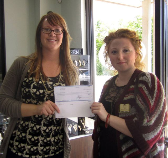 Check Presented to Bella Vista Library by Ashley Linden at Linden's Custom Jewelry & Diamonds