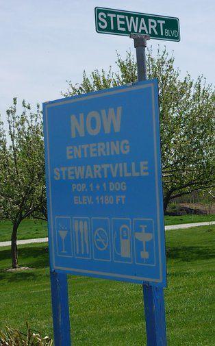 'Now entering stewartville' entrance sign