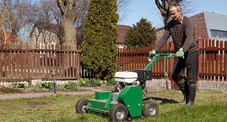 Machine designed to aerate the soil in which lawn grasses grow