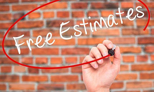 Man hand writing free estimates