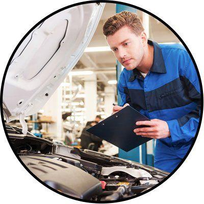 city west automotive mechanic checking car