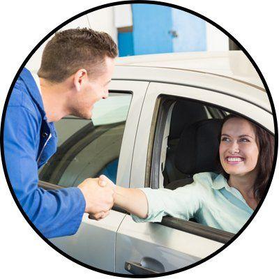 city west automotive woman hand shaking to mechanic