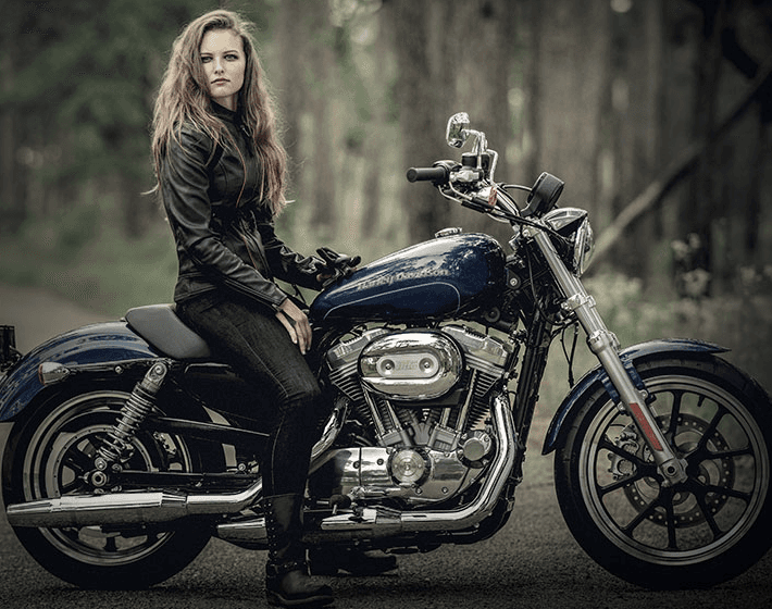 Young women riding Harley Davidson