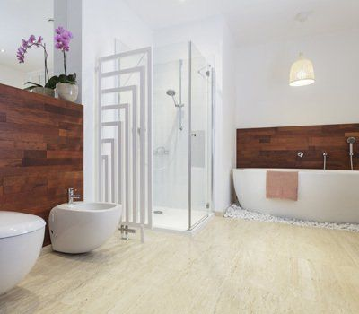Bathroom with timber wall panels, cream floor, and corner shower stall