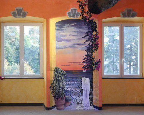 due finestre e un disegno di una porta con vista del mare